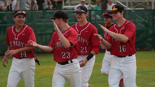 Orchard Lake St. Mary's celebrates a win over Dearborn Divine Child during the quarterfinals on Tuesday at Wayne State.