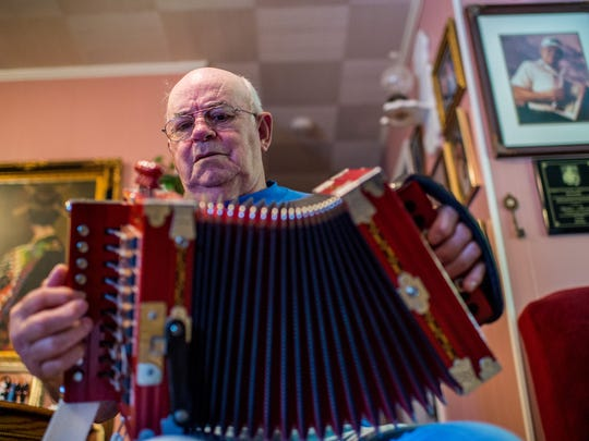 Cajun musician Walter Mouton plays a song on his accordion at his home in Scott, La., Tuesday, Nov. 10, 2015.