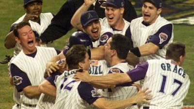 Diamondbacks celebrate after beating the Yankees in the 2001 World Series