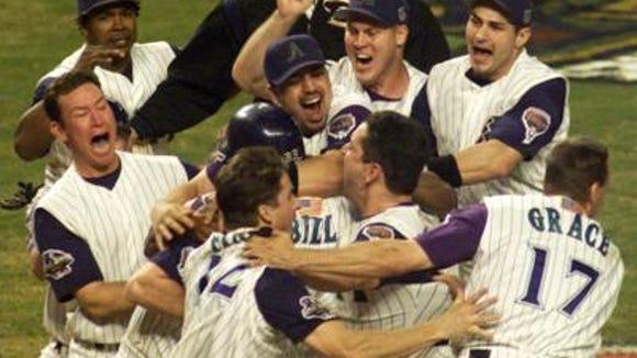 Diamondbacks celebrate after beating the Yankees in