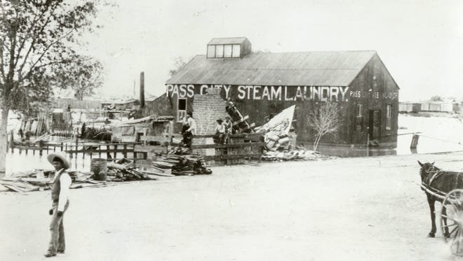 Pass City Steam Laundry at Santa Fe Street is shown during the great flood in late May and early June 1897.