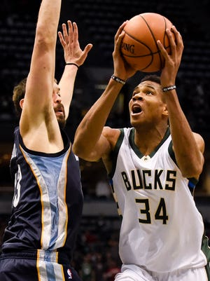 Bucks forward Giannis Antetokounmpo shoots against Memphis Grizzlies center Marc Gasol in the fourth quarter Saturday night at BMO Harris Bradley Center. Antetokounmpo scored 27 points to help the Bucks beat the Grizzlies 106-96.