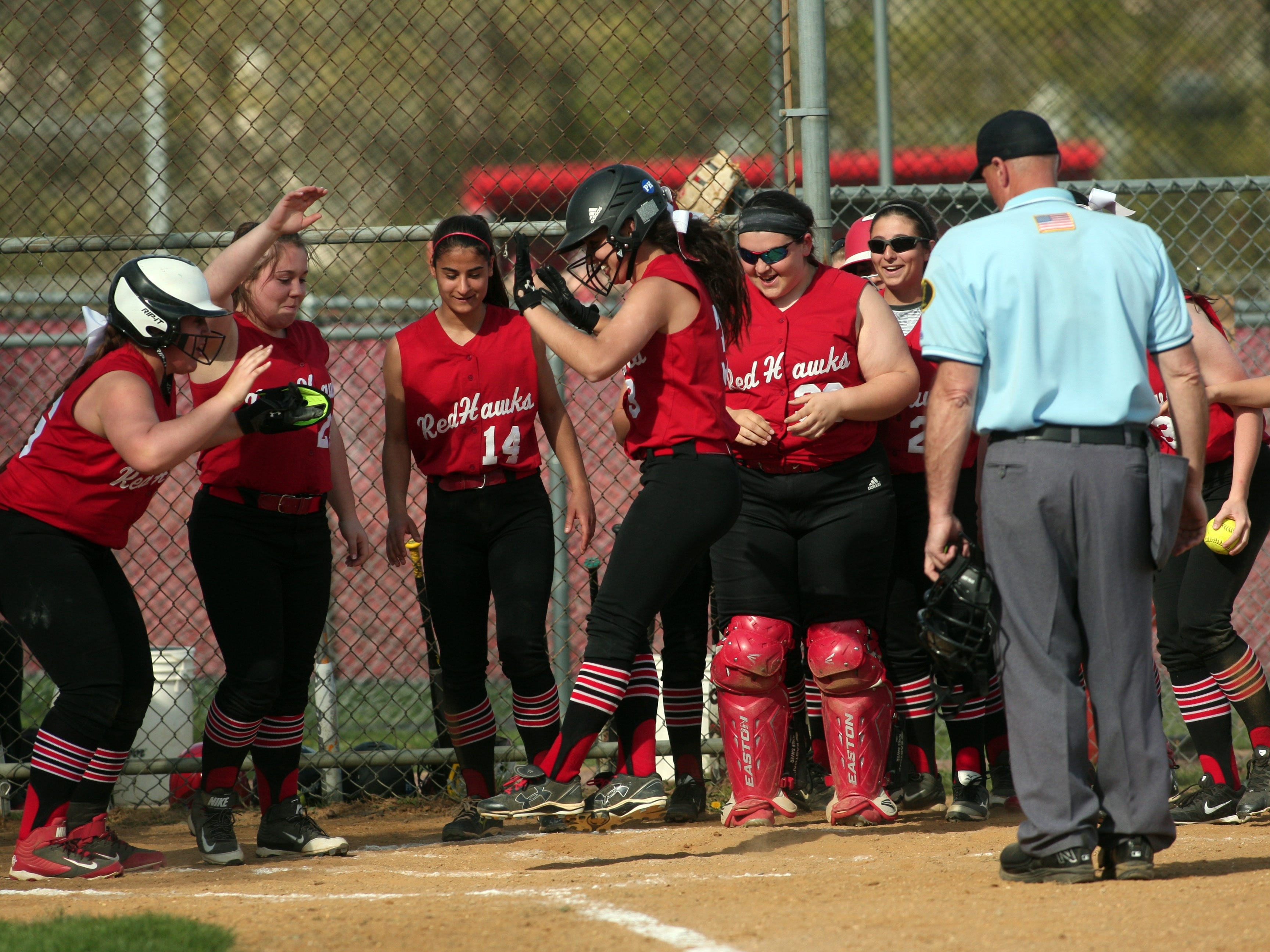 Parsippany's Kaila Migliazza (3) is congratulated after a home run vs. Mendham during their softball matchup in the first round of the Morris County Tournament. Parsippany winning 11-7 to advance. April 28, 2015. Parsippany, N.J. Bob Karp/Staff Photographer.