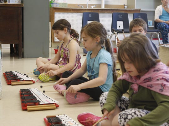 """Second-graders at Kent Primary School learn to play a short song in Juliana Schultz's music class. In third grade, they can start playing the recorder. In fourth grade, chorus begins. Music classes would expand to kindergarten if Carmel voters approve full-day kindergarten. Schultz says her task is to teach her students how to think like musicians, which includes learning when to be in """"rest position,"""" not playing."""