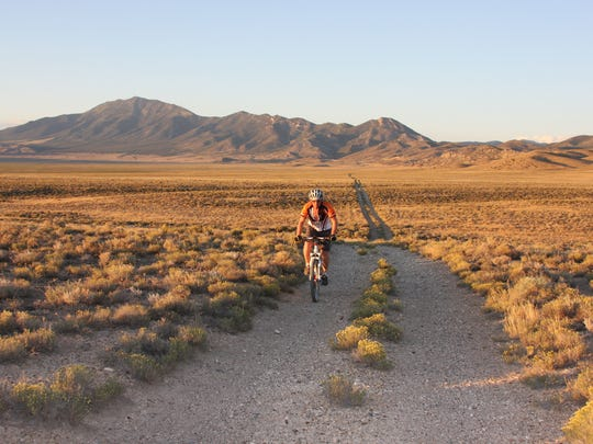 Trevor Oxborrow of Carson City rides across the Railroad Valley on the route of the Comstock EPIC, which is a bikepacking course across Nevada.