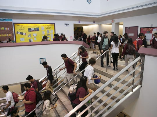 ASU Preparatory Academy high school students walk between classes at ASU Preparatory Academy in Phoenix on May 26, 2015.