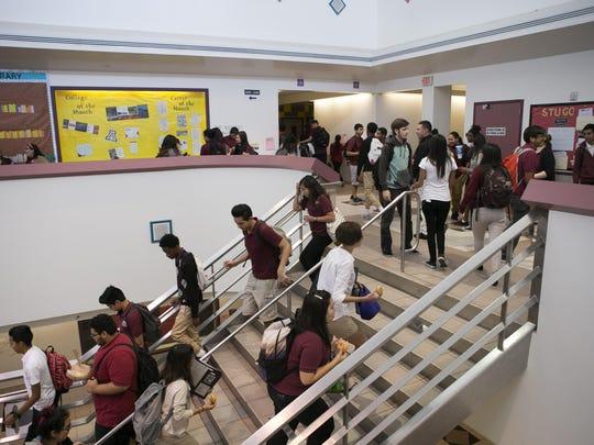 ASU Preparatory Academy high school students walk between classes at ASU Preparatory Academy in Phoenix on May 26, 2015.