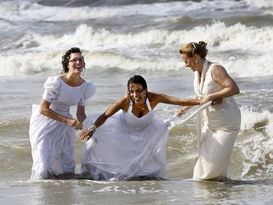 Women wearing their wedding dresses are