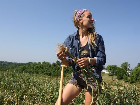 holding garlic profile view