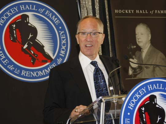 St. Clair's Mike Emrick gives his acceptance speech at the Hockey Hall of Fame in Toronto after winning the Foster Hewitt Memorial Award, presented annually as a broadcaster lifetime achievement award. He was inducted into the U.S. Hockey Hall of Fame in 2011, and was recently announced as the Vin Scully Award winner for lifetime achievement in sports broadcasting.