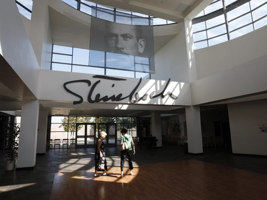 Donna Pray, left, and Vicki Campanella walk toward the small movie theater to see a short film about John Steinbeck at the National Steinbeck Center.