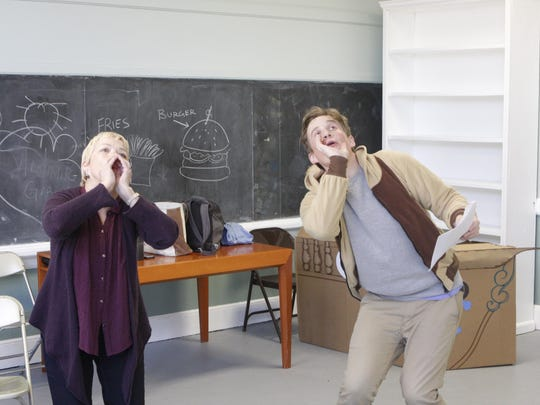 """Musician Donna Reilly and actor Augustus Jacobson practice their """"Call of the Wild"""" howls in rehearsal for """"Bookmarks,"""" a show written specifically for an audience on the autism spectrum. """"Bookmarks,"""" by the Yellow Finch Project, premiered this spring at the Schoolhouse in Croton Falls and returns in October to Armonk's Whippoorwill Hall. After a dress rehearsal, Jacobson said: """"If the audience is howling with us, objective met."""""""