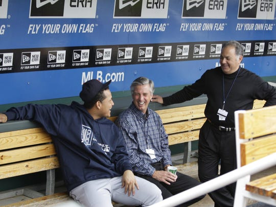 From left, Detroit Tiger Miguel Cabrera talks with Dave Dombrowski and Al Avila in the dugout before a game against the Kansas City Royals in October 2012. Avila, as Dombrowski's assistant with the Florida Marlins, led the effort to sign Cabrera for $1.8 million when he was 16 years old.