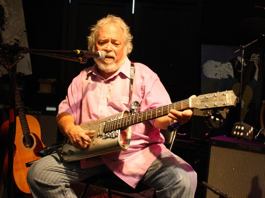 Frank Greathouse, a historian of Piedmont-style blues who performs under the name Screamin' and Cryin', plays slide on his custom guitar fashioned from automotive parts and decorations. He performed at the 2013 Southwest Florida Blues Society International Blues Challenge regional qualifier.