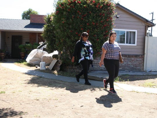 Salinas Senior Code Enforcement Officer Sylvia Perez and Code Enforcement Officer Cindy Guerrero leave a property after following up on a complaint submitted about it.