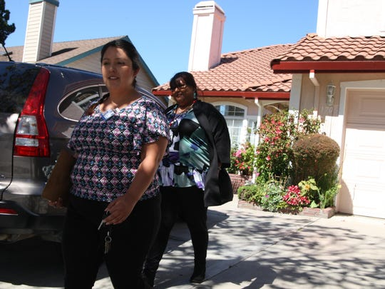 Salinas Senior Code Enforcement Officer Sylvia Perez (right) and Code Enforcement Officer Cindy Guerrero leave a property after following up on a complaint submitted about it.