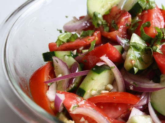 "Tomato Cucumber Salad from the cookbook ""Dinosaur Bar-B-Que: An American Roadhouse."""