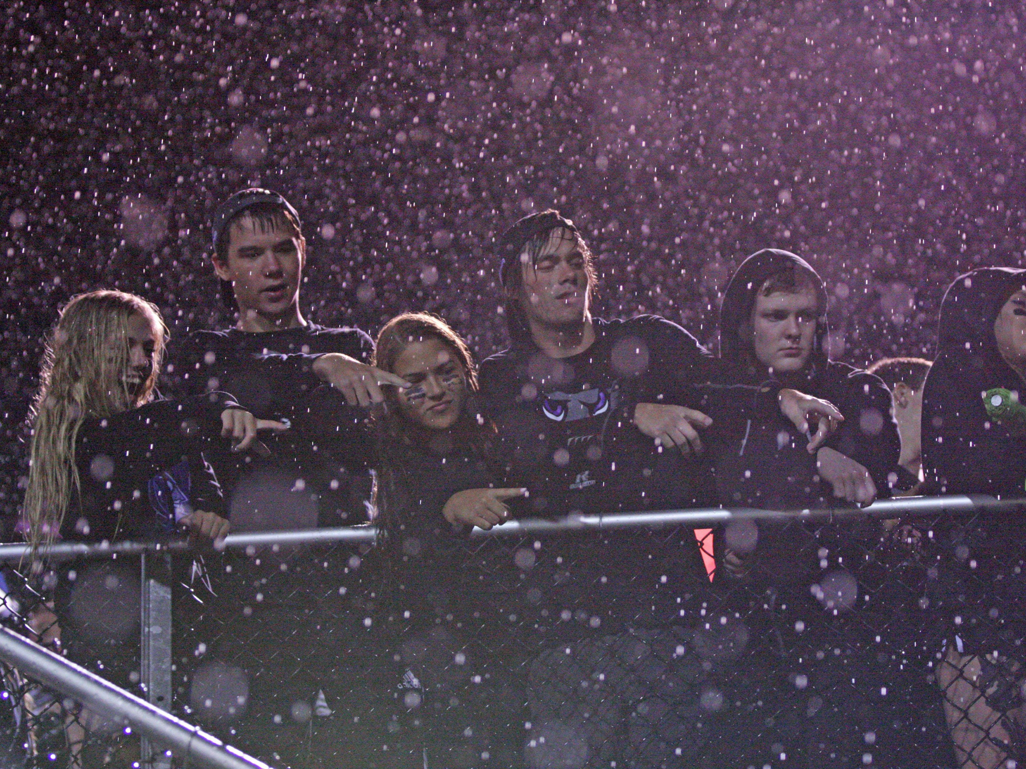 Fans braved the elements and watched the Little Giants defeat Sandusky 34-7.
