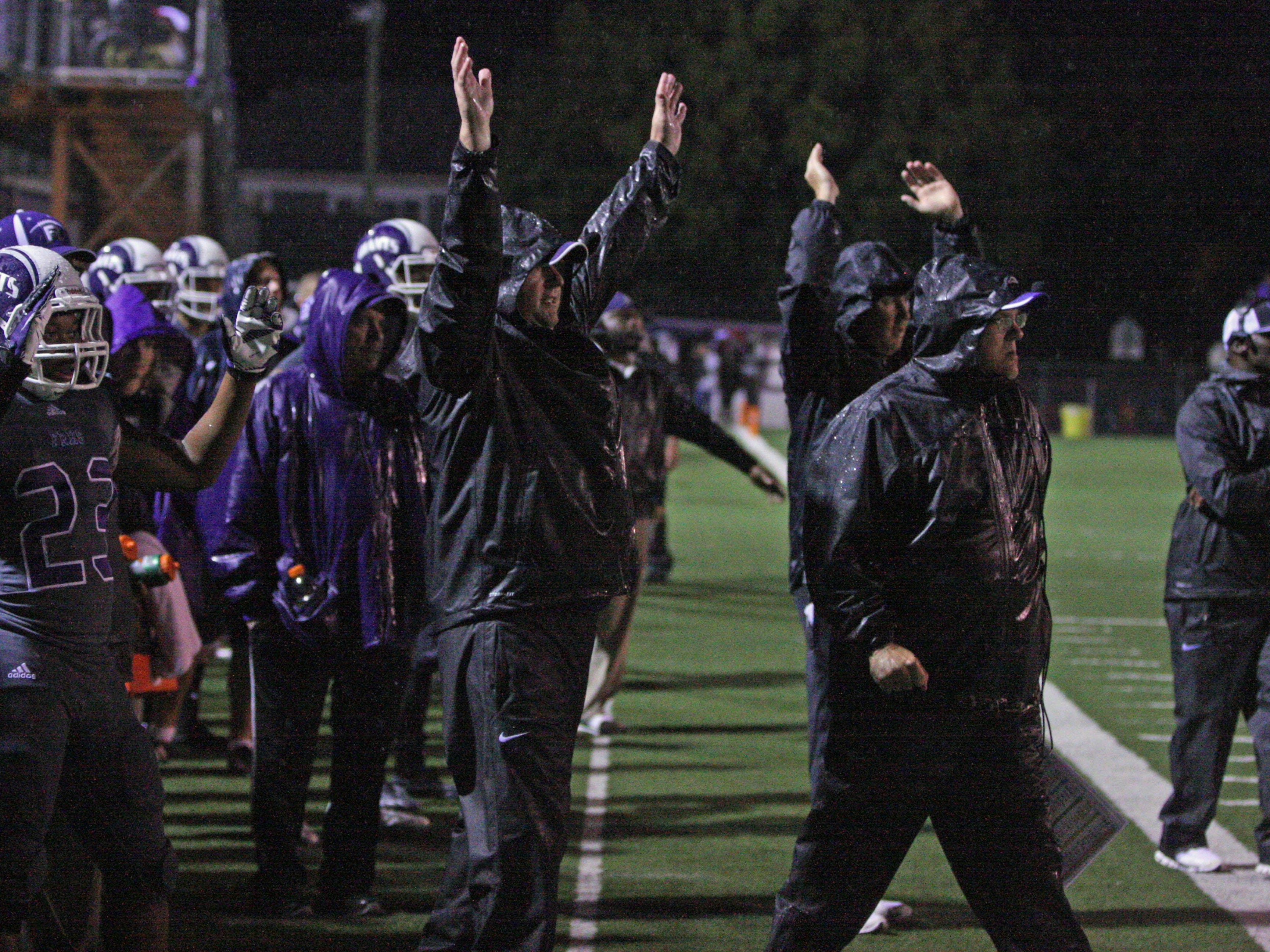 Ross' siideline reacts to a 4th quarter touchdown against Sandusky.