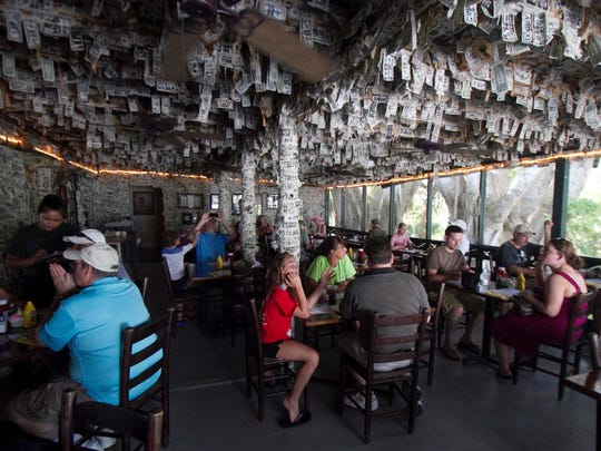 "The Cabbage Key bar, also known as the ""bar with the money on the walls,"" will be open and serving this Christmas."