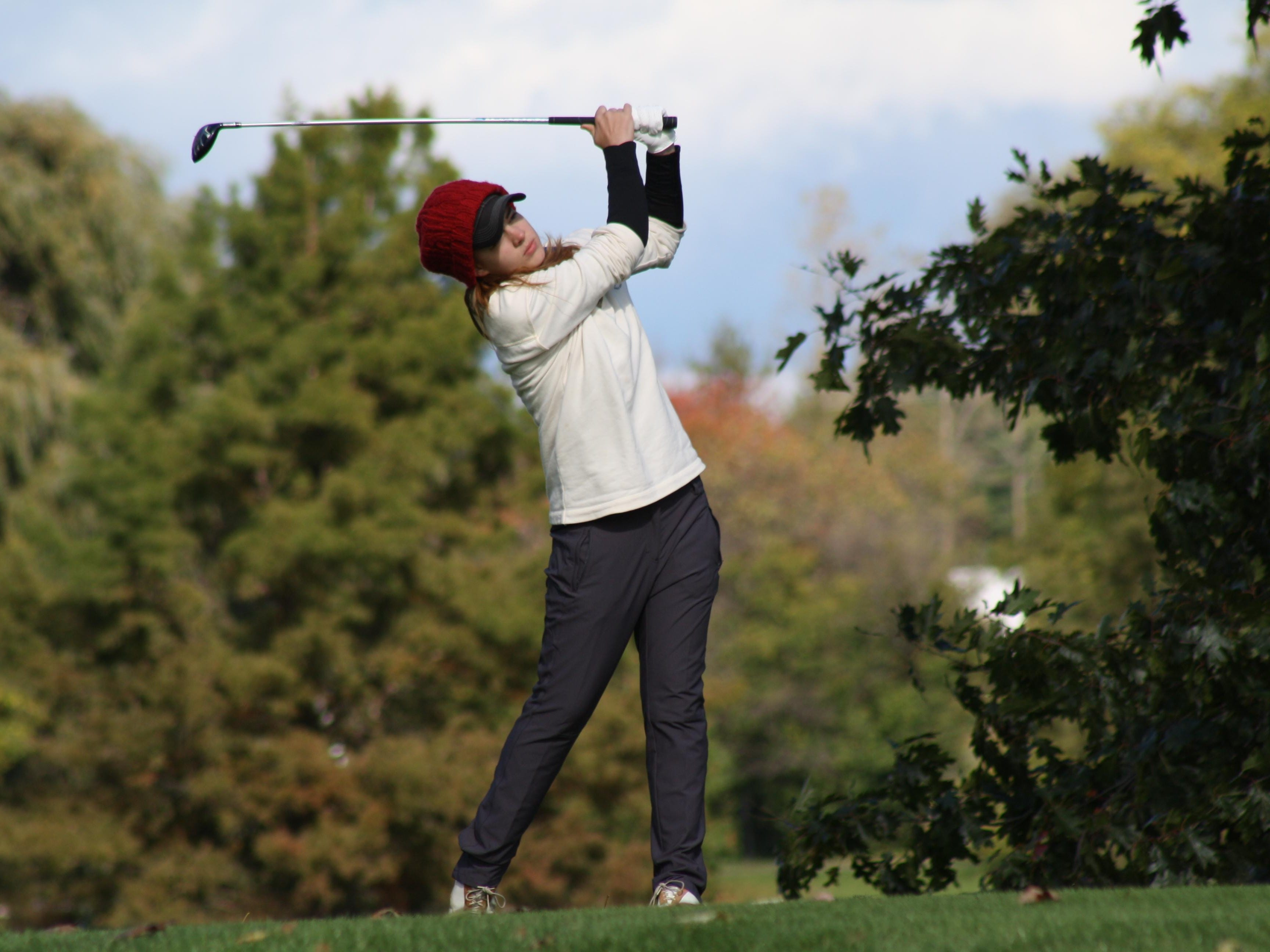 Driving off the 10th tee, Jessica Zylstra, a senior at Grand Rapids Northpointe Christian.