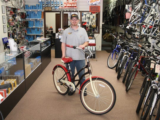 Displaying a retro fat tire bike, Kenny Trammell of Valley Bikes runs a full service bike shop on W. Alisal