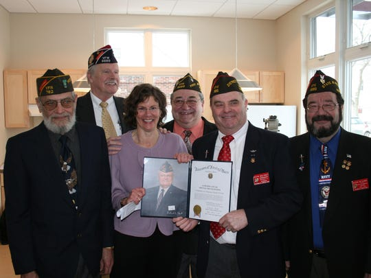 Veterans honor COTS Executive Director Rita Markley at the opening of Canal Street Veterans Housing in 2011. These Vietnam veterans formed the Canal Street Veterans Housing Advisory Board, which helped COTS in the planning and opening of the building.