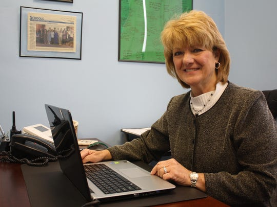 A Community Press feature article about St. Thomas School Principal Deborah Flamm's time spent as a teacher at St. Bernadette School in Amelia hangs behind her desk. Flamm said she has an empty wall she is filling up with St. Thomas School students' accomplishments.