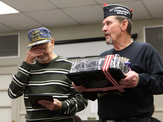Highland Township resident Chet Johnson, 88, became a bit emotional when he realized VFW Post 9914 Commander Tom Oltesvig, was about to hand him a World War II-era navy uniform.