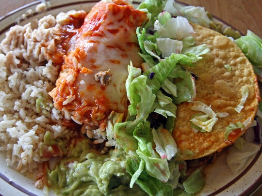 A luncheon combo with pork tamale and chicken taco