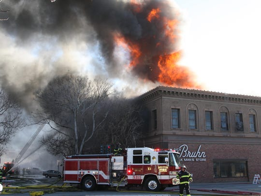 Battling the blaze begins from outside the Dick Bruhn building, Saturday, Feb.13, 2016