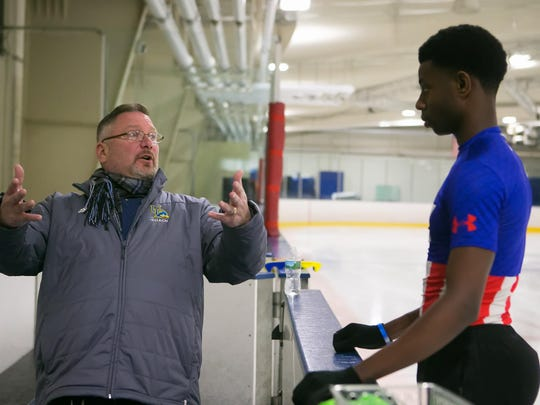 Coach Jeff DiGregorio gives Glasgow High senior Emmanuel Savary tips during his practice at the Gold Arena Ice Skating Rink in Newark.