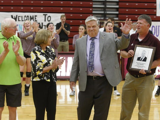 Former Ankeny volleyball coach Dave Whims was inducted into the Dick Rasmussen Coaches Hall of Honor prior to a match on Sept. 20. Whims is shown with his wife, Darlene, and Rasmussen, left. Mike Bakker, one of Whims' longtime assistant coaches, holds the plaque that was presented to Whims.
