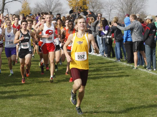 Ankeny's Tim Sindt sets the early pace while Ankeny Centennial's Camden Cox follows close behind in the boys' Class 4A state cross country meet on Oct. 29 at Lakeside Golf Course in Fort Dodge. Cox went on to place fourth in a time of 15 minutes 51 seconds, while Sindt finished eighth in 16:01 to lead the Hawks to a 13th-place finish in the team standings.