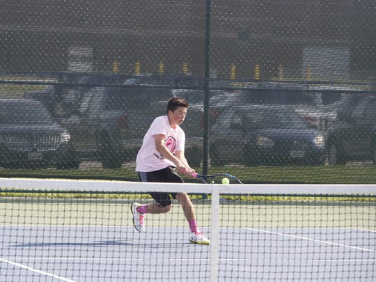 Ankeny Centennial's Sam Marold returns a shot during last year's dual meet against Ankeny. Marold is one of only four returning varsity regulars for the Jaguars.