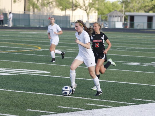 Ankeny Centennial's Adrie Gunn advances the ball during a game against Mason City last season.