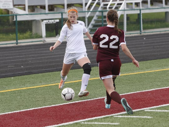 Ankeny Centennial's Kenzie Geiger looks to take a shot