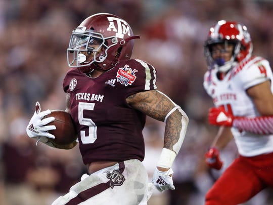 JACKSONVILLE, FL - DECEMBER 31: Trayveon Williams #5 of the Texas A&M Aggies runs for a 17-yard touchdown against the North Carolina State Wolfpack in the third quarter of the TaxSlayer Gator Bowl at TIAA Bank Field on December 31, 2018 in Jacksonville, Florida. Texas A&M won 52-13. (Photo by Joe Robbins/Getty Images)