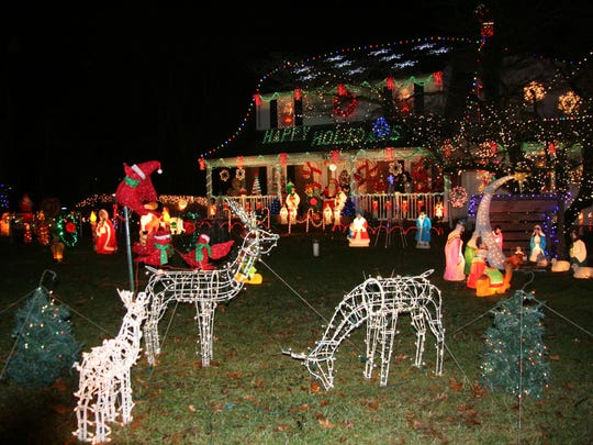 "Edward Parze's Freehold home is in the running for ""best holiday lights display"" in the country."