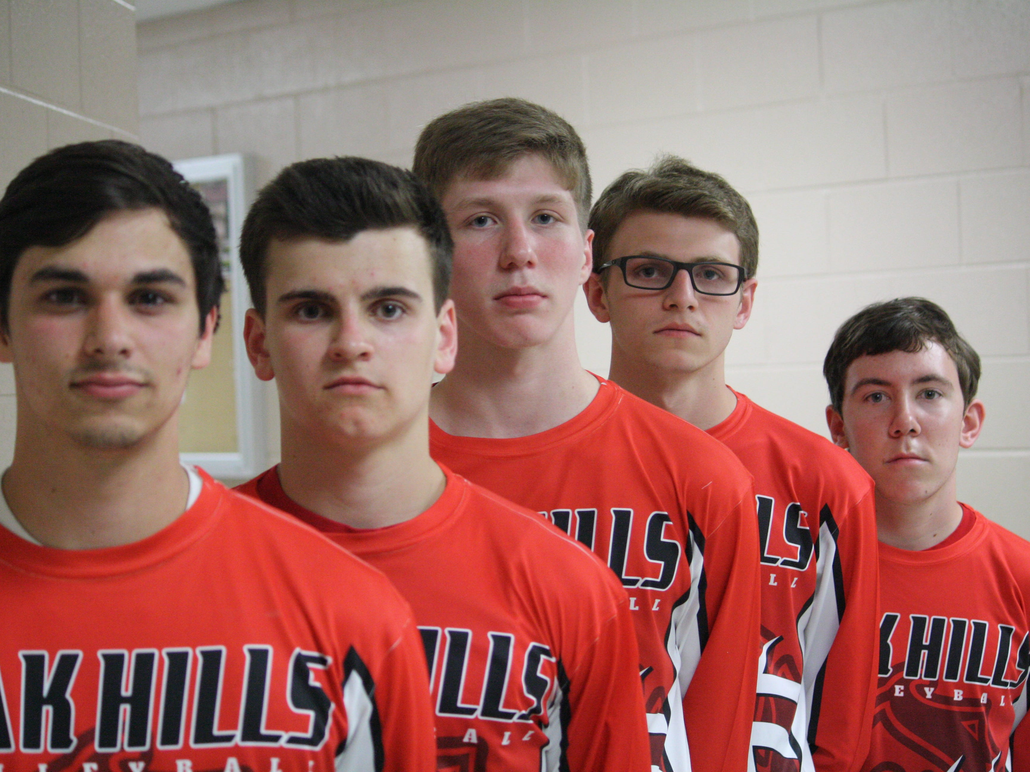 Oak Hills senior volleyball players, from the front, Eric Schneider, Alec Krummen, Tim Laib, Dylan Miller and Randy Hager get together April 16 before facing Mason.