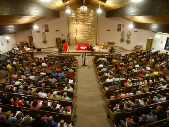 Residents of several communities pack St. John the Baptist Catholic Church in Peosta on Aug. 4 during a prayer service for four boys who died in a crash near Epworth.