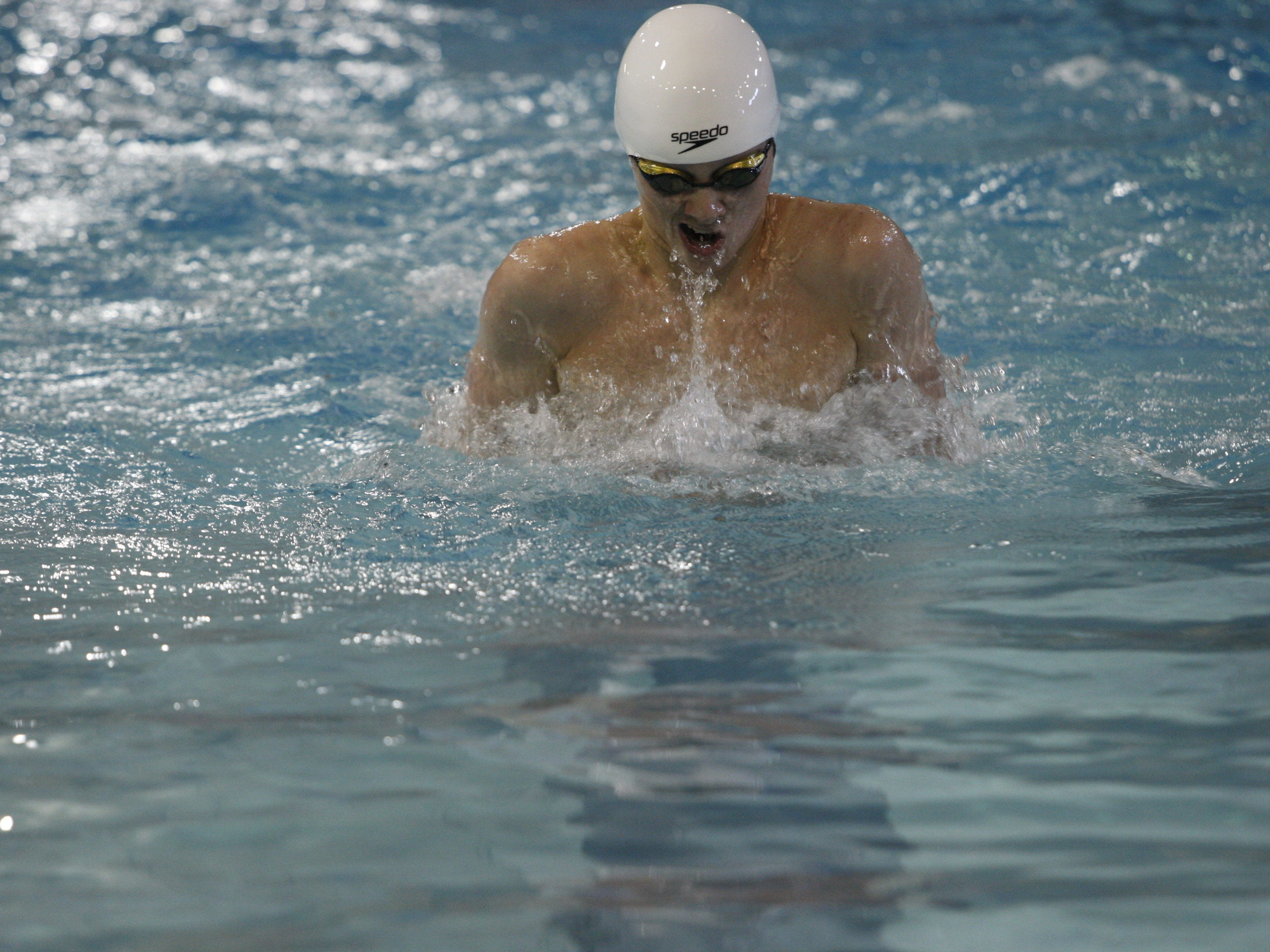 Ankeny's John Breen swims the breaststroke leg of the 200 medley relay during the state meet on Saturday at Marshalltown. Breen helped the Hawks to an 11th-place finish in the event. He teamed up with Jeff Hyler, Will Martin and Zach Deaton to post a time of 1:37.88.
