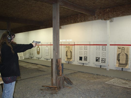 Tammy Evans practices shooting at the indoor shooting