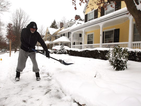 Timothy Knight shovels snow from his sidewalk in Morristown as the impending snowstorm heading for New Jersey was a bust for Morris County. January 27, 2015. Morristown, N.J.