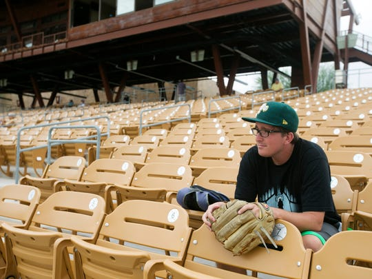 Sam Carlson of Walnut Creek, Calif., watches a Fall League game at Camelback Ranch.
