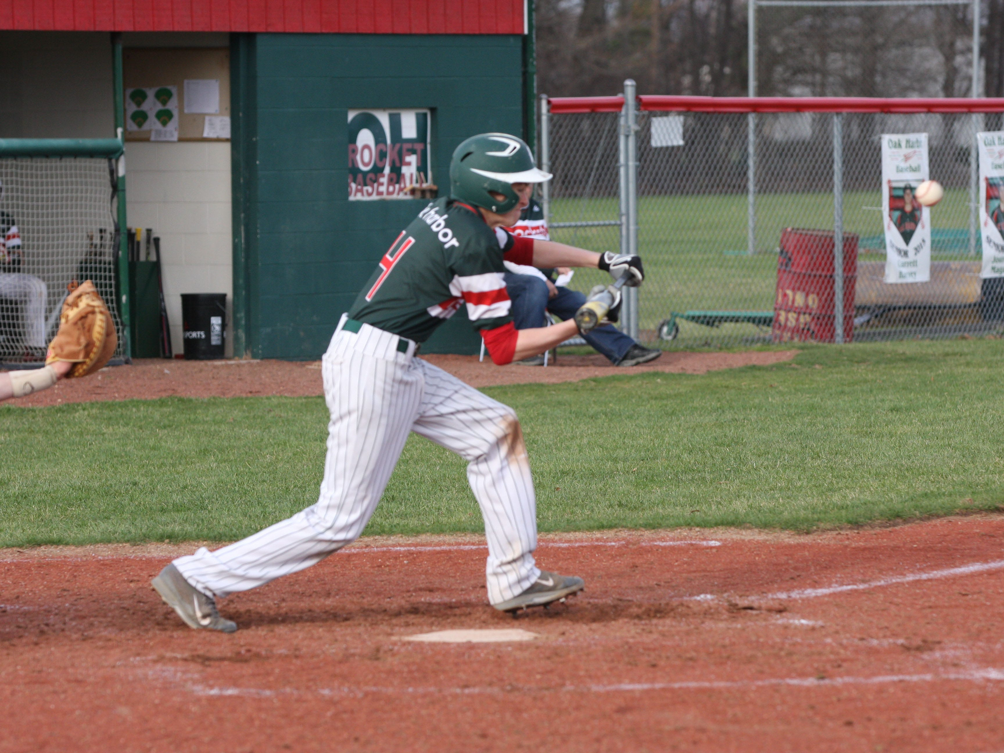 Oak Harbor's TJ Hartman lays down a sacrifice bunt in the sixth inning Tuesday against Port Clinton.