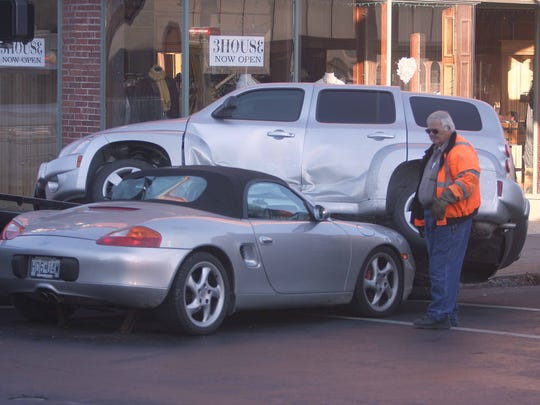 A tow truck driver has to untangle two cars after a