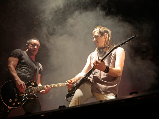 Nine Inch Nails Trent Reznor (left) and Robin Finck perform during the Bonnaroo Arts and Music Festival on June 14, 2009, in Manchester, Tennessee.