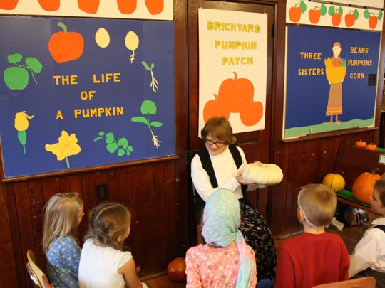 Marie Rein teaches students a science lesson about the life cycle of pumpkins at Brickyard School.