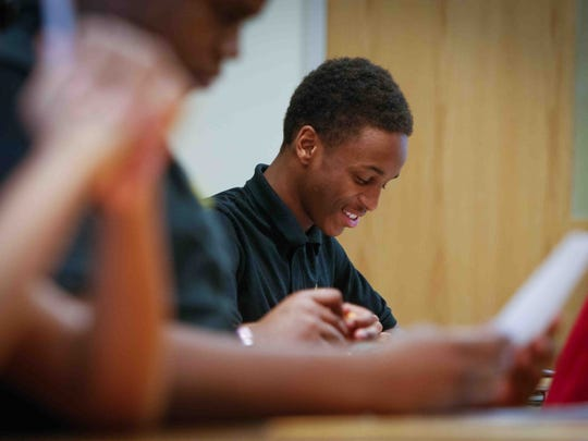 Marquis Thomas, 16, answers a question correctly in his English class at Moyer Academy in Wilmington Thursday.
